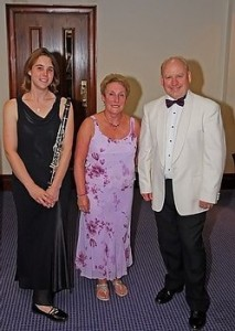 Margaret Frogson (centre) pictured here with Gill Henshaw (leader) and Keiron Anderson (conductor), NSWO.  (Photo PT Graphics)